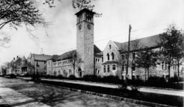 An old photo of Queen's University campus, featuring Kingston Hall